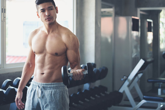 Fitness man doing exercise in gym