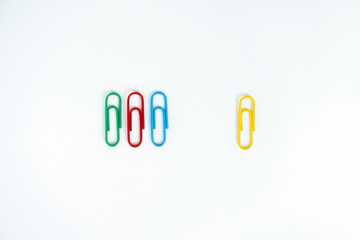 Business concept of difference employee for group of colorful paperclip and another difference yellow paperclip