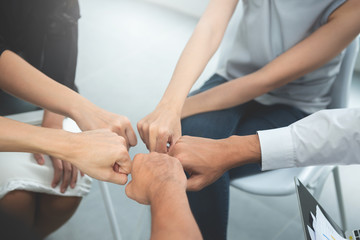 Asian business people group join the hand for collaboration and support, team work concept
