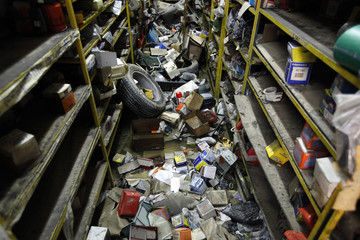 Destroyed stock items and debris are seen in a damaged store after flash floods rushed through Birkirkara, outside Valletta