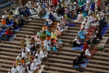 Men offer Eid al-Fitr prayers marking the end of the holy fasting month Ramadan at Jama Masjid (Grand Mosque) in the old quarters of Delhi