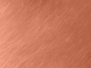 Copper metal texture with circular scratches.