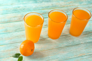 Fresh citrus juice in glasses on table
