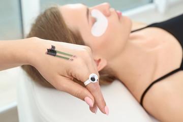 Beautician preparing for eyelash extensions procedure, closeup