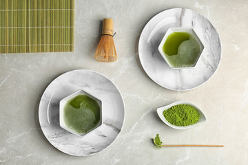 Flat lay composition with matcha tea on table