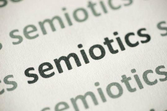 word semiotics printed on paper macro