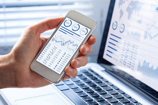 Investor analyzing stock market with financial dashboard on smartphone, computer