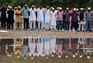 Men offer Eid al-Fitr prayers marking the end of the holy fasting month Ramadan at a mosque, in Chandigarh