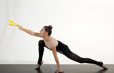 Workout sports activities in gym of flexible girl. Sport success and health. Fitness and dieting of girl gymnast. Woman train acrobatics with mace. Woman with mace for rhythmic gymnastic
