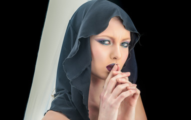 Sexy woman in black hood. Fashion model with makeup of mysterious girl. Black Friday concept. Gothic fashion and beauty. Makeup look and skincare sensual of girl. Religion and death concept.