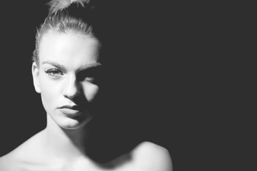 Monochrome low key portrait of beautiful woman