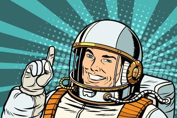 pop art astronaut points up