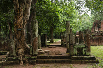 View landscape of buddha statue at Wat Phra Si Iriyabot in ancient building and ruins city of Kamphaeng Phet Historical Park