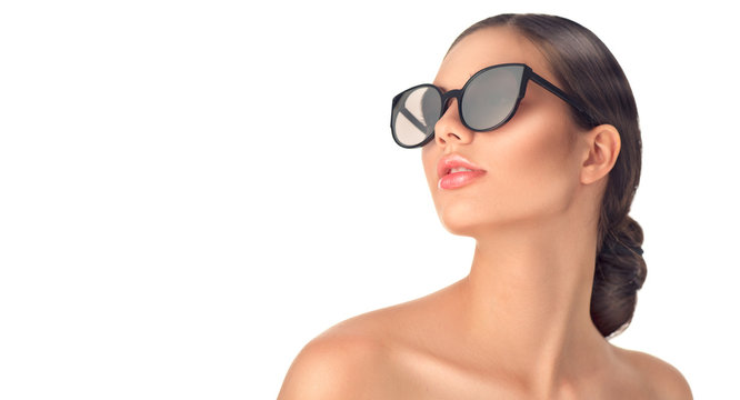 Beauty fashion model girl wearing sunglasses. Beautiful woman portrait over white background