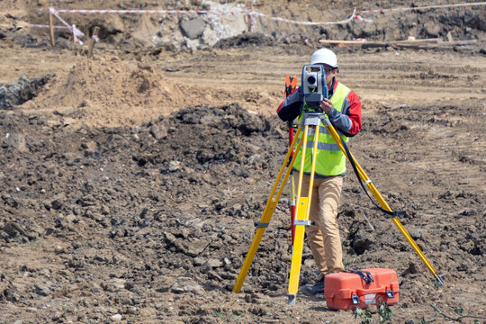 The surveyor is shooting at a building site