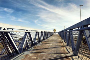 metal overpass bridge to the blue sky
