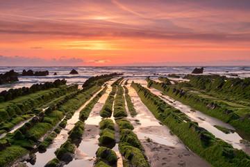 amazing sunset landscape at rocky beach