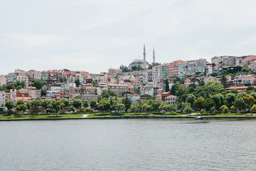 A beautiful view of the houses and the mosque in Istanbul in Turkey from the side of the Bosphorus