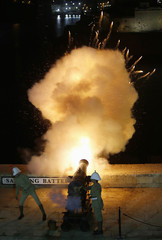 National Heritage Trust historical re-enactors in Victorian-era Royal Malta Artillery uniform fire a cannon at the Upper Barrakka Saluting Battery during Notte Bianca (White Night) celebrations in Valletta