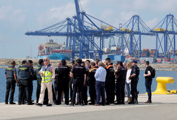 Police and Civil Guard staff hold a briefing next to the point of arrival of refugee vessel Aquarius and two other Italian ships expected tomorrow at the port of Valencia