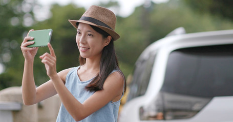 Travel woman taking photo between road trip