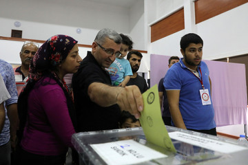 Turkish voters cast their ballots for Turkey's presidential elections in the Turkish Cypriot northern part of the divided city of Nicosia