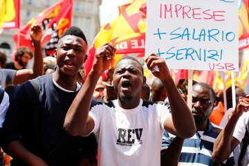 People react as they take part in a national demonstration to show solidarity with migrants, after Soumaila Sacko a 29-year-old migrant agricultural worker, was shot and killed in southern Italy early this month, Rome