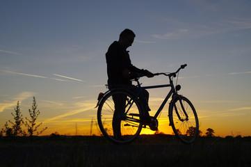 Man starting drive on bicycle