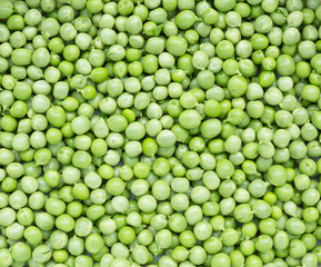 Green peas background texture top view.
