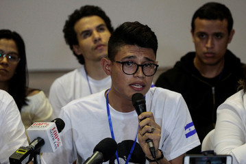 Student leader Lester Aleman speaks during a press conference after participating in the national dialogue in Managua