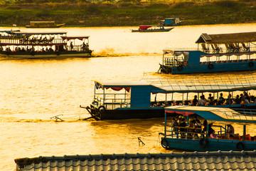 Many boatsmen in port of floating village, Phnom Krom, Tonle Sap, Cambodia