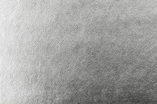 Silver background wrapping foil paper shiny white grey metallic leather texture backdrop for wall paper decoration element