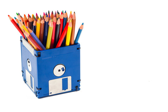 recycle floppy disk, Creative objects used for obsolete furniture. - Developed a color pencil box, concept recycle floppy disk, isolate white background copy space