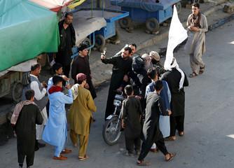 People take selfies with the Taliban in Kabul
