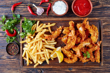 deep-fried shrimps with french fries, flat lay