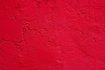 Background of a red stucco coated and painted exterior, rough cast of cement and concrete wall texture, decorative coating