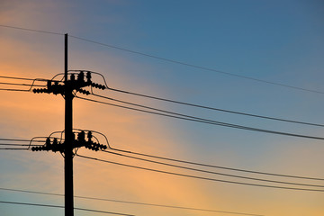 Red blue sunset with telegraph poles