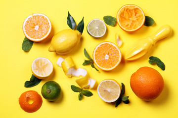 Citrus and juicer on a bright yellow background. View from above