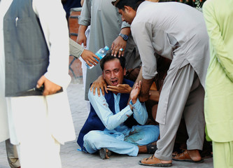 An Afghan man mourns in a hospital after a car bomb, in Jalalabad city