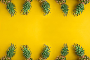 Pineapple Whole tropical fruits with leaves Yellow background Useful Natural organic food Top view Flat Lay Group Objects