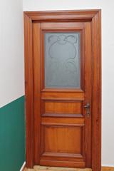 porte en bois ancienne avec vitrage et dessins art déco