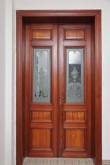 double porte en bois ancienne avec vitrage et dessins art déco