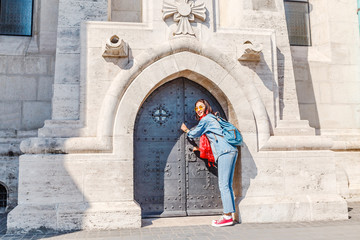 The tourist woman at gate of the old castle