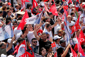 Supporters of Muharrem Ince, presidential candidate of Turkey's main opposition Republican People's Party (CHP), wave flags during an election rally in Istanbul