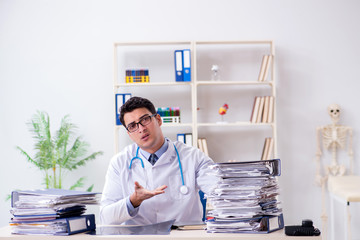 Busy doctor with too much work in hospital