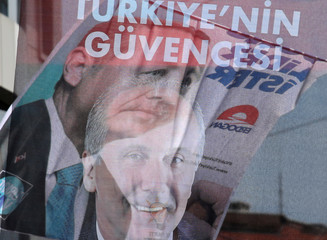 A banner of Turkish President Tayyip Erdogan and a banner of Muharrem Ince, presidential candidate of the main opposition Republican People's Party (CHP) hang in a street in Istanbul