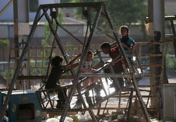 Iraqi children play as they celebrate Eid al-Fitr, in Najaf