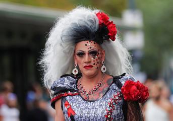 A reveller participates in Regenbogenparade gay pride parade in Vienna