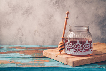 Honey jar on wooden table