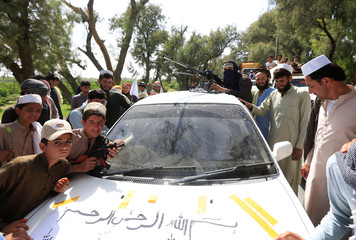 People gathered Taliban as they celebrate ceasefire in Bati Kot district of Nangarhar province, Afghanistan